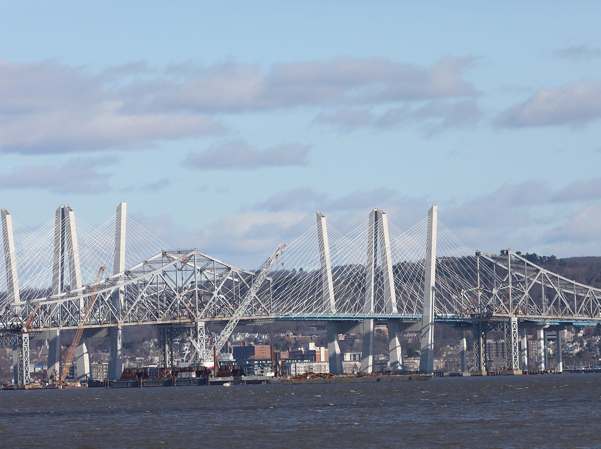 The remaining structure of the Tappan Zee Bridge, in front of the new Gov. Mario M. Cuomo Bridge, photographed from Piermont on Dec. 4.