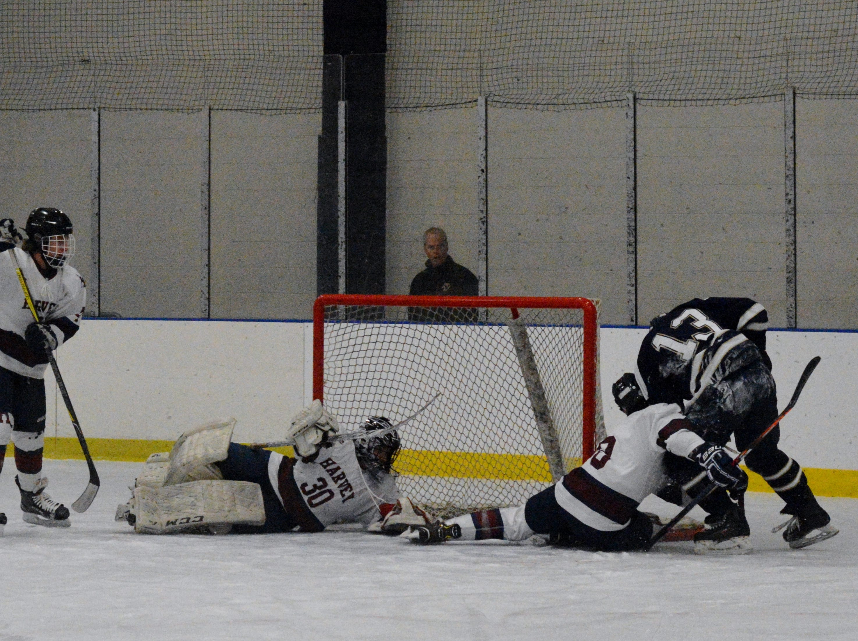 Cavaliers goalie Jake Hellinger extends to stop a Josh Cohen shot in the first period.