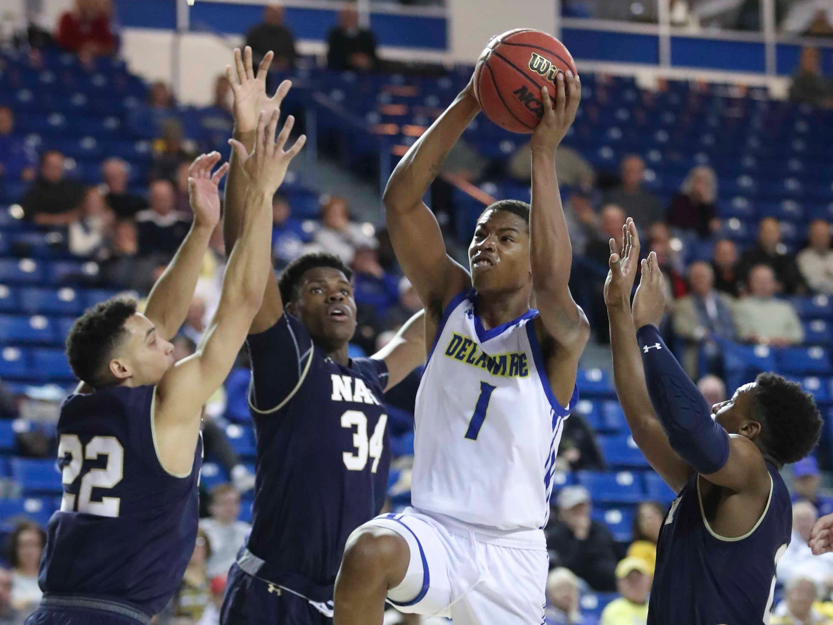 Delaware's Kevin Anderson (1) cuts to the net against Navy's (from left) Cam Davis, Danny Ogele and Hasan Abdullah in the second half of Delaware's 80-65 loss at the Bob Carpenter Center Wednesday.