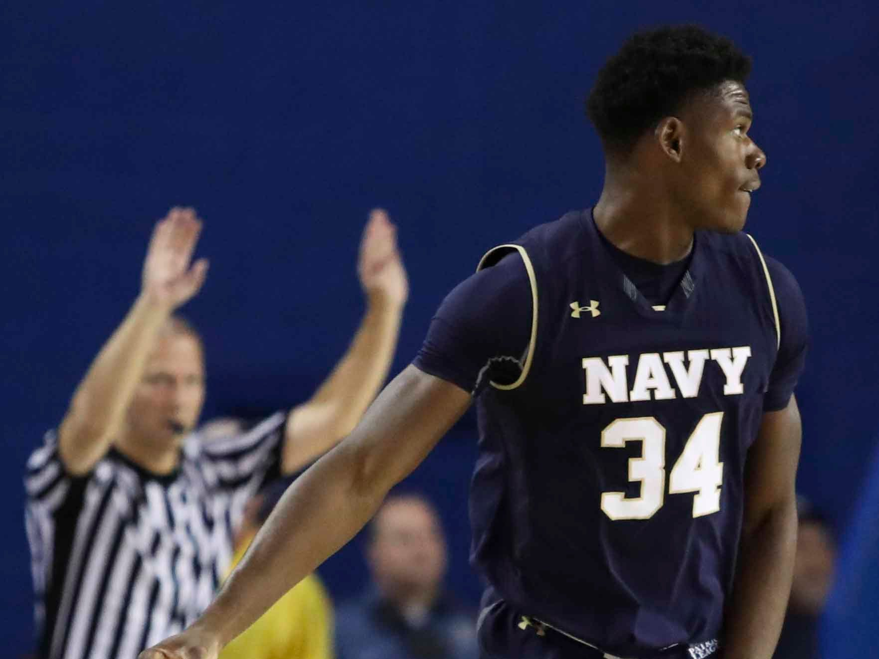 Navy's Danny Ogele reacts after hitting a three-pointer in the first half at the Bob Carpenter Center Wednesday.