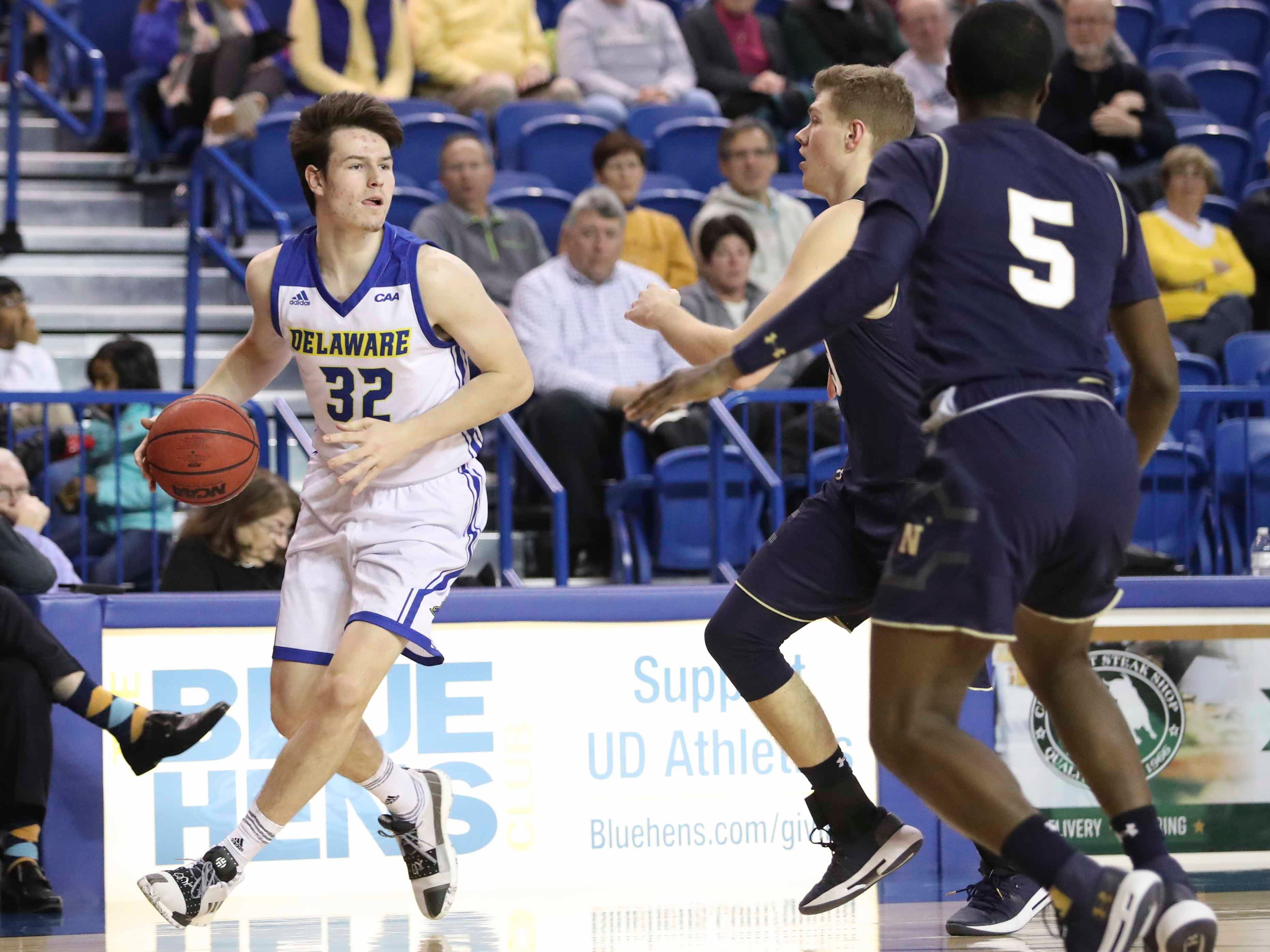 Delaware's Matt Veretto looks past the Navy defense in the first half at the Bob Carpenter Center Wednesday.