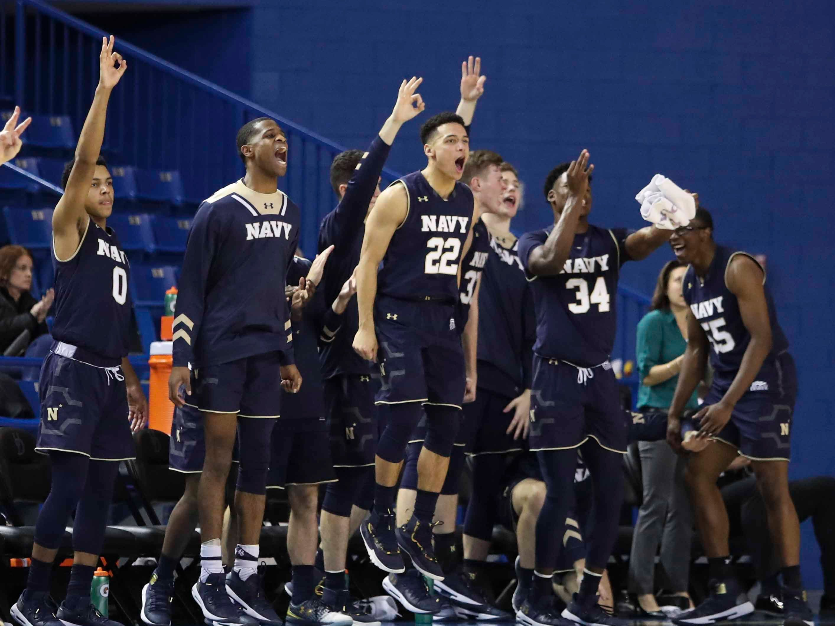 The Navy bench reacts as the Midshipmen turn on the shooting in the second half of Delaware's 80-65 loss at the Bob Carpenter Center Wednesday.
