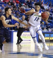 Delaware's Ithiel Horton (right) tries to move past Navy's Evan Wieck in the first half at the Bob Carpenter Center Wednesday.