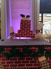 The Hotel du Pont pastry team assembles the fireplace, which is made of fondant.