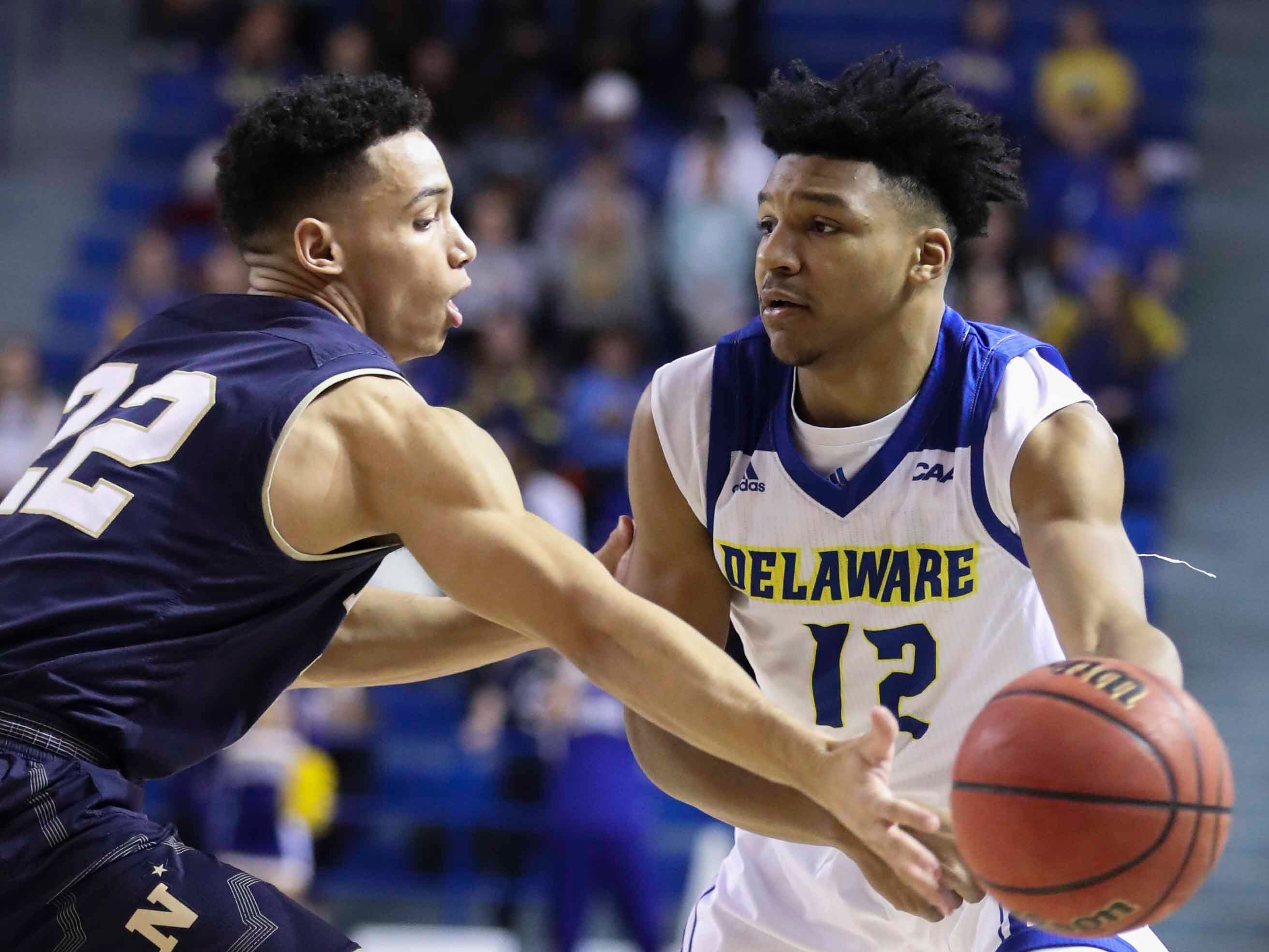 Navy's Cam Davis defends against Delaware's Ithiel Horton in the first half at the Bob Carpenter Center Wednesday.
