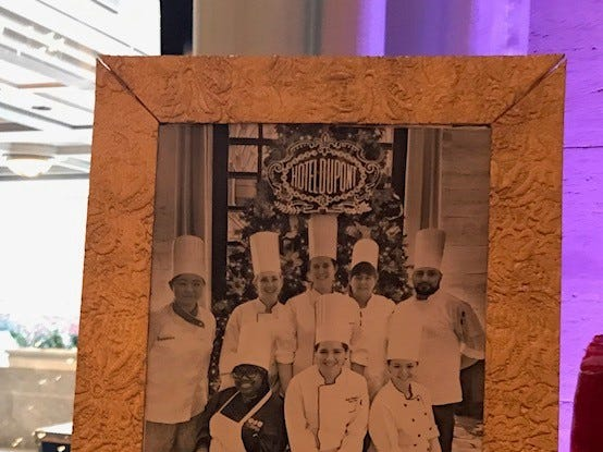 A photo of the pastry team sits on the mantle of the edible display.