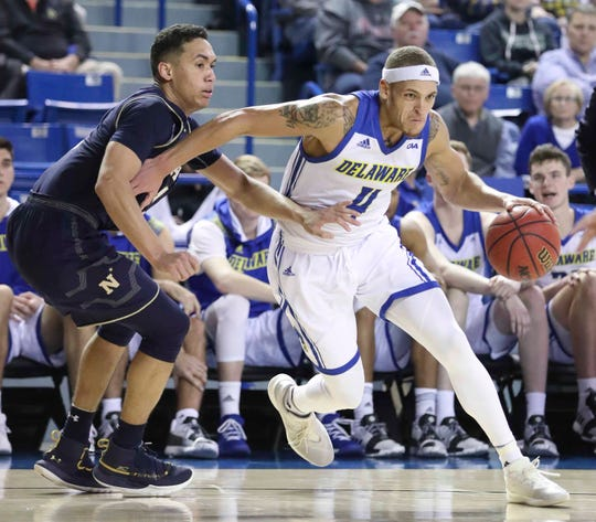 Delaware's Darian Bryant pushes past Navy's John Carter, Jr. in the second half of Delaware's 80-65 loss at the Bob Carpenter Center Wednesday.