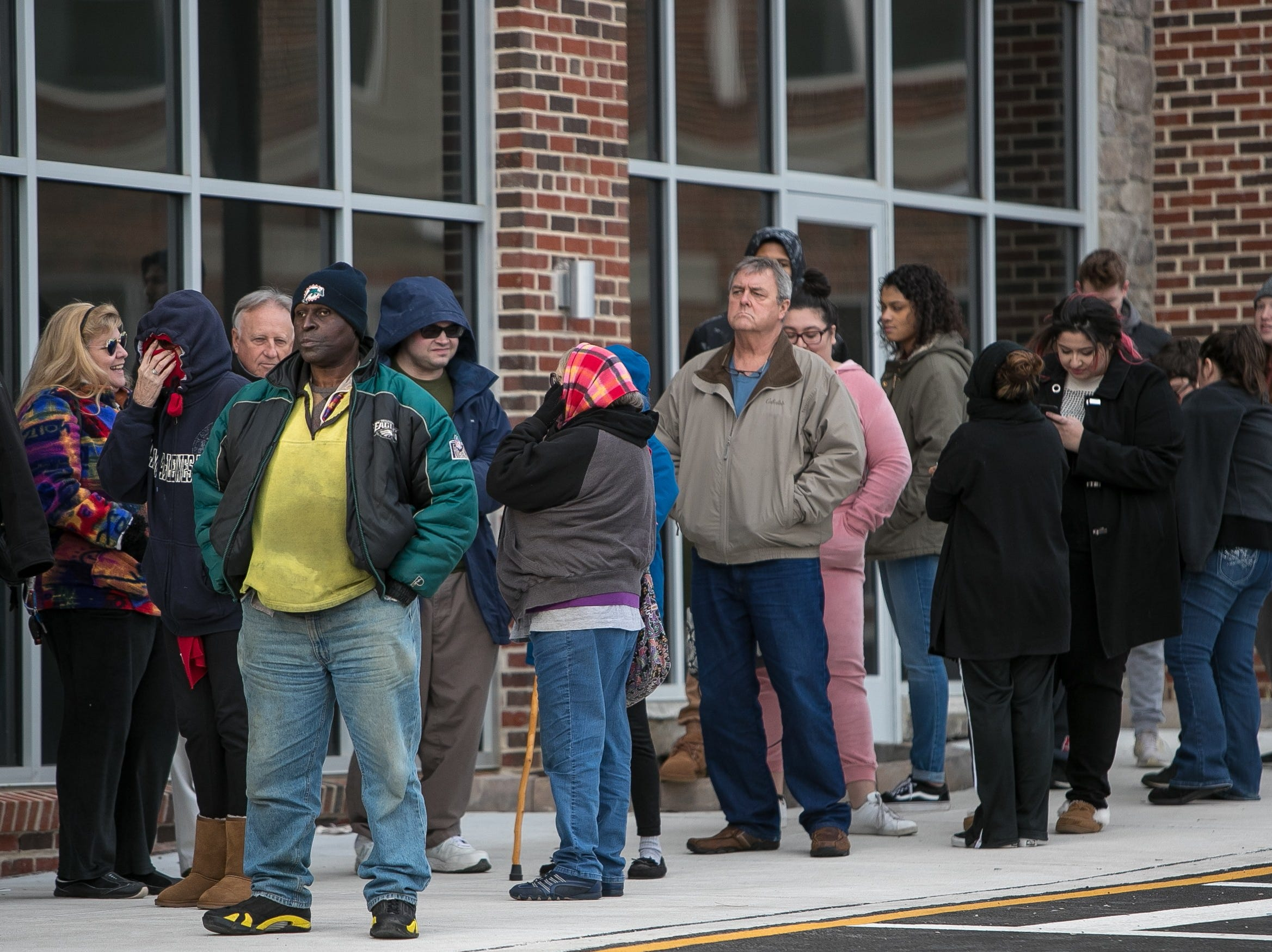 "People line up waiting 30-40 minutes to get into 1000 Degrees Pizza in Pike Creek who are giving away a free 10"" pizza with your choice of toppings to every customer who comes in till 8pm Thursday, Dec. 6, 2018."