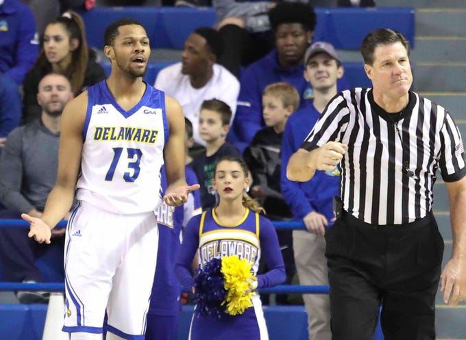 Delaware's Ryan Johnson can't believe he was called for a foul in the first half at the Bob Carpenter Center Wednesday.