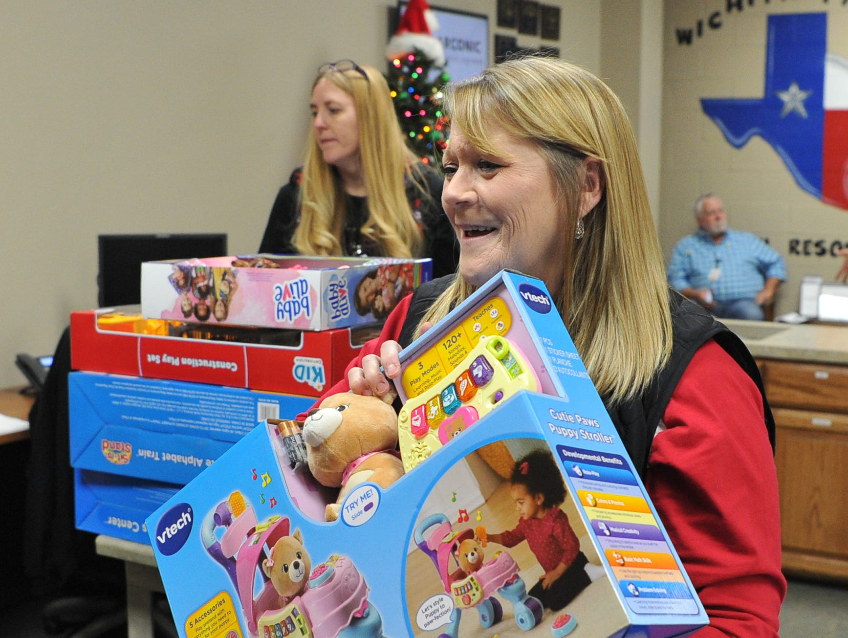 Elissa Depew, left, and Kelly Davis sort donated toys from Wichita Falls Alcoa employees for to Child Care Partner kids Thursday afternoon.