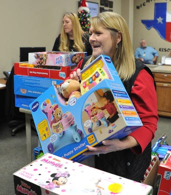 Wichita Falls Acronic employees help with Christmas for kids with Child Care Partners