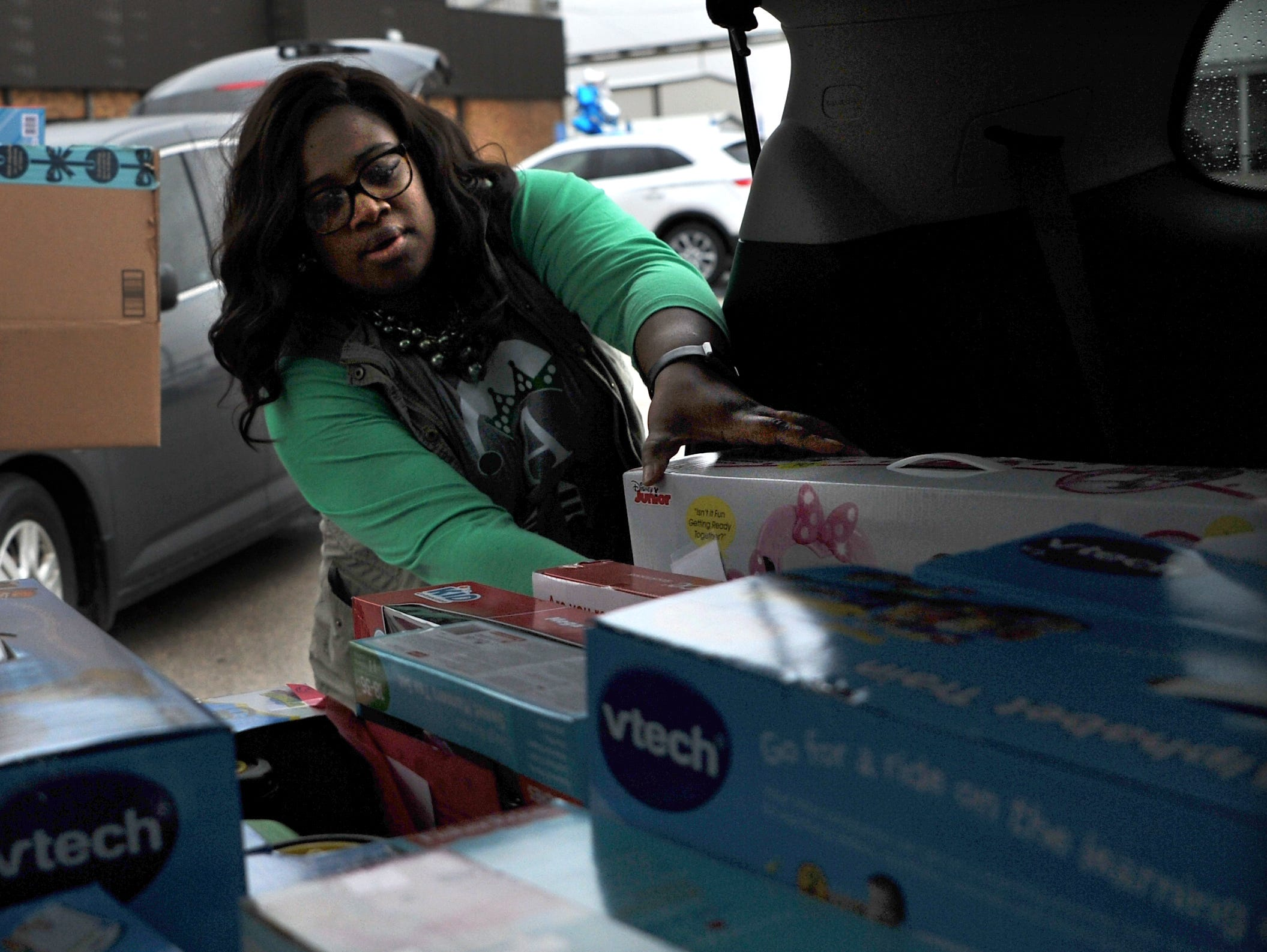 Child Care Partners, Center Service Coordinator, Anndrea Harris helps load donated toys from Alcoa employees Thursday afternoon.