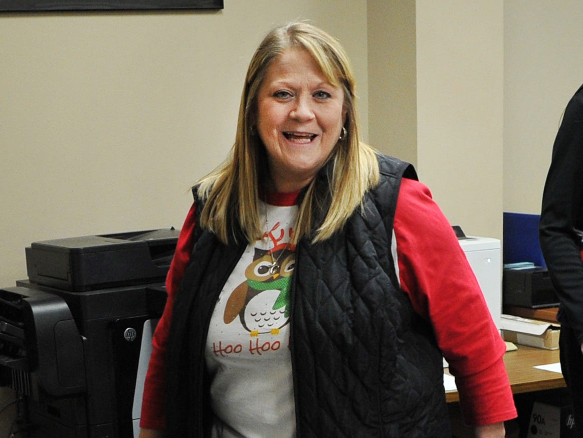 Child Care Partners Kelly Davis helps load donated toys from Alcoa employees Thursday afternoon.