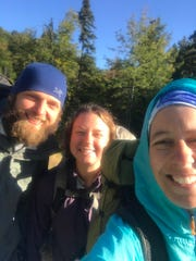 Jade Schultheis, center, is pictured with Squirv and Flash, two hikers she met along the Appalachian Trail. They were preparing to leave Rangely, Maine. Jade and Flash were hiking together and Squirv was passing through going the opposite direction.