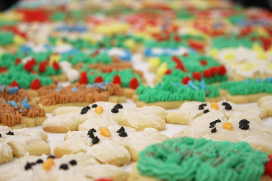 Volunteers used over 130 pounds of frosting to decorate thousands of cookies Thursday for PAWS annual Cookie Walk.