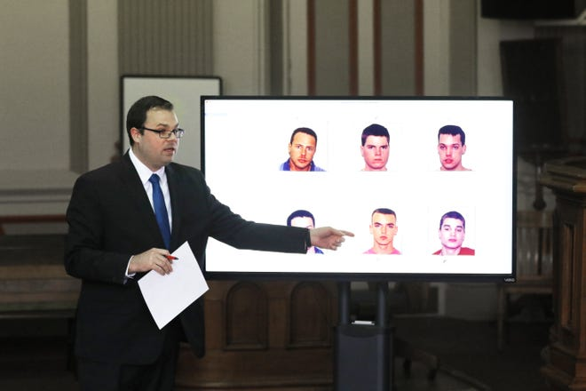 Muskingum County Assistant Prosecutor Gerald Anderson points to John Iden in a photo array shown to alleged rape victims during John Iden's trial in Muskingum County Common Pleas Court on Thursday.