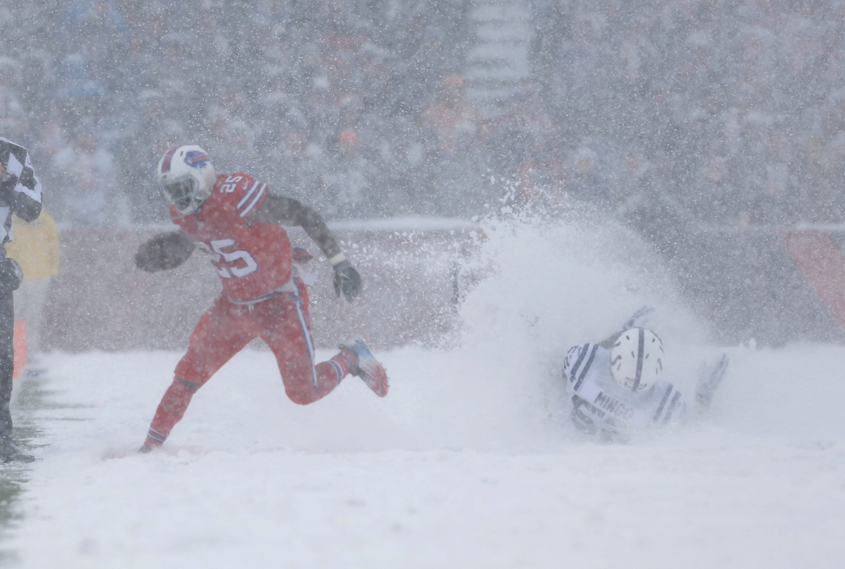 Dec. 10, 2017: Buffalo Bills running back LeSean McCoy runs past Indianapolis Colts outside linebacker Barkevious Mingo in a snow storm at New Era Field. The Bills won in overtime, 13-7.