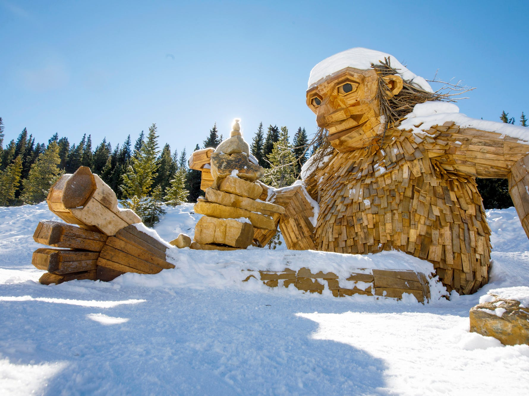 "The large wooden troll, ""Isak Hearthstone,"" made by artist Thomas Dambo, sits in the snow Wednesday, Nov. 14, 2018, along the Wellington Trail in Breckenridge, Colo."