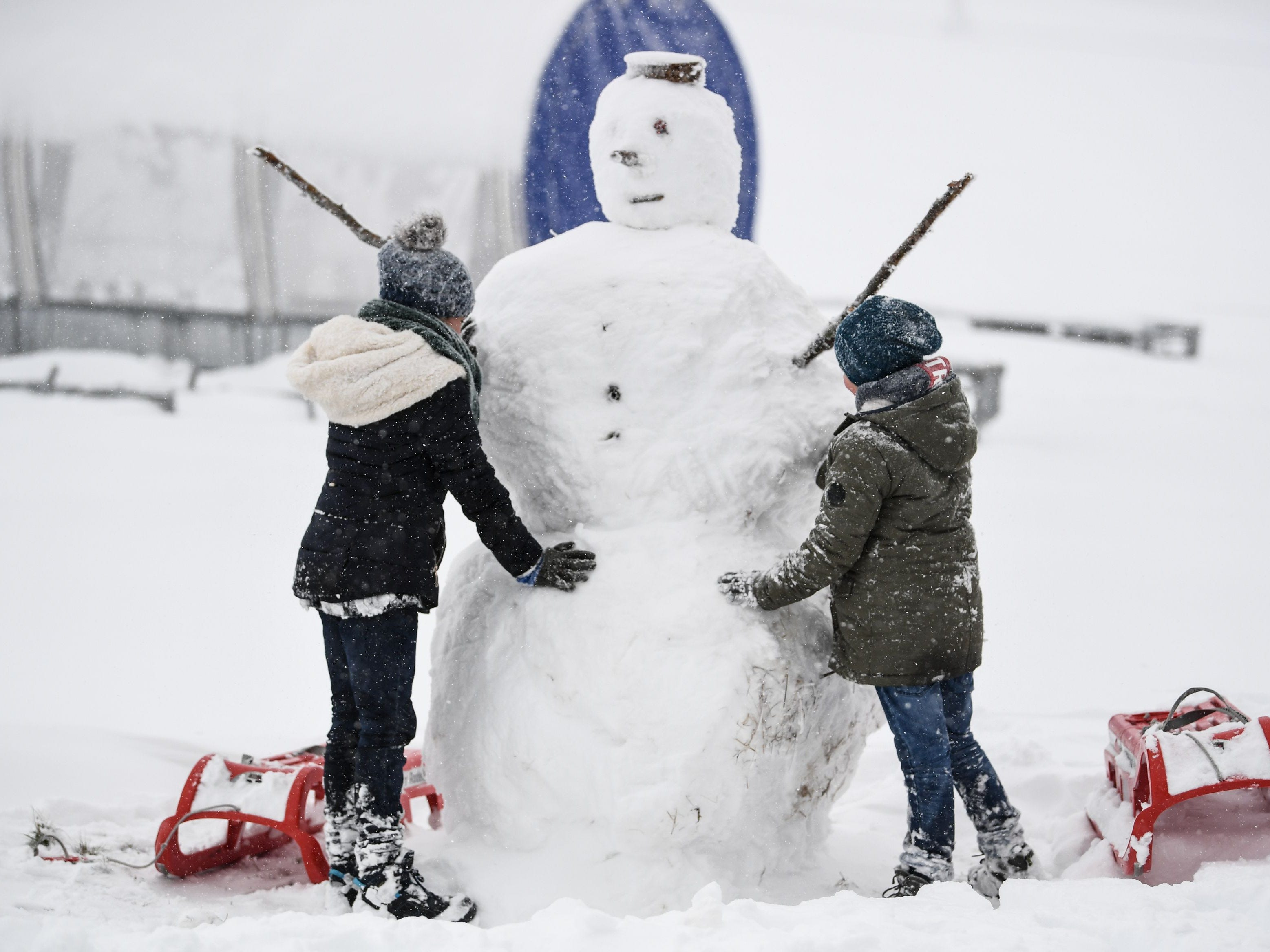 Children build a snowman in Feldberg, Germany, on Oct. 28, 2018.