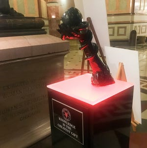 This display from The Satanic Temple-Chicago has been placed in the Statehouse rotunda at the Capitol in Springfield, Ill. It joins the Nativity scene to mark the Christmas season and the Menorah to mark Hanukkah.