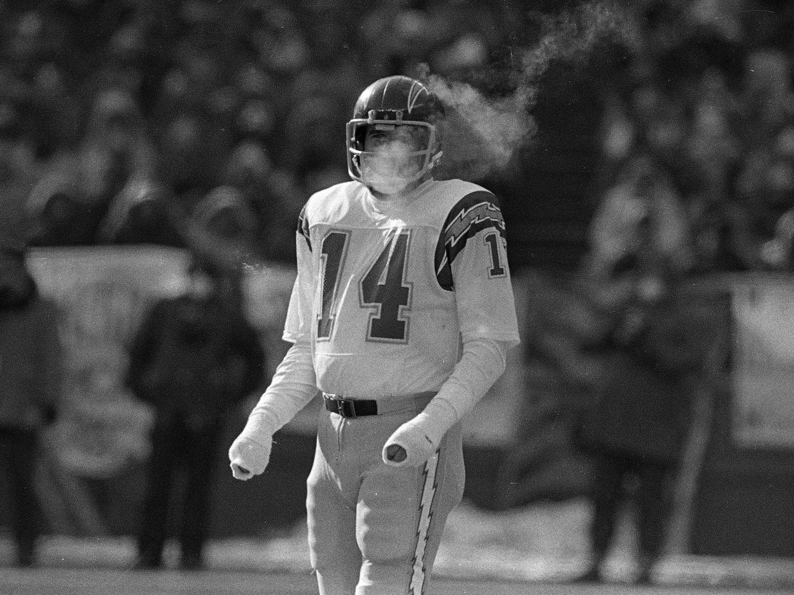 "Jan. 10, 1982: San Diego Chargers quarterback Dan Fouts face is obscured by his steaming breath during the 1981 AFC Championship Game at Riverfront Stadium in Cincinnati. The Bengals won, 27-7, in what became known as the ""Freezer Bowl."""