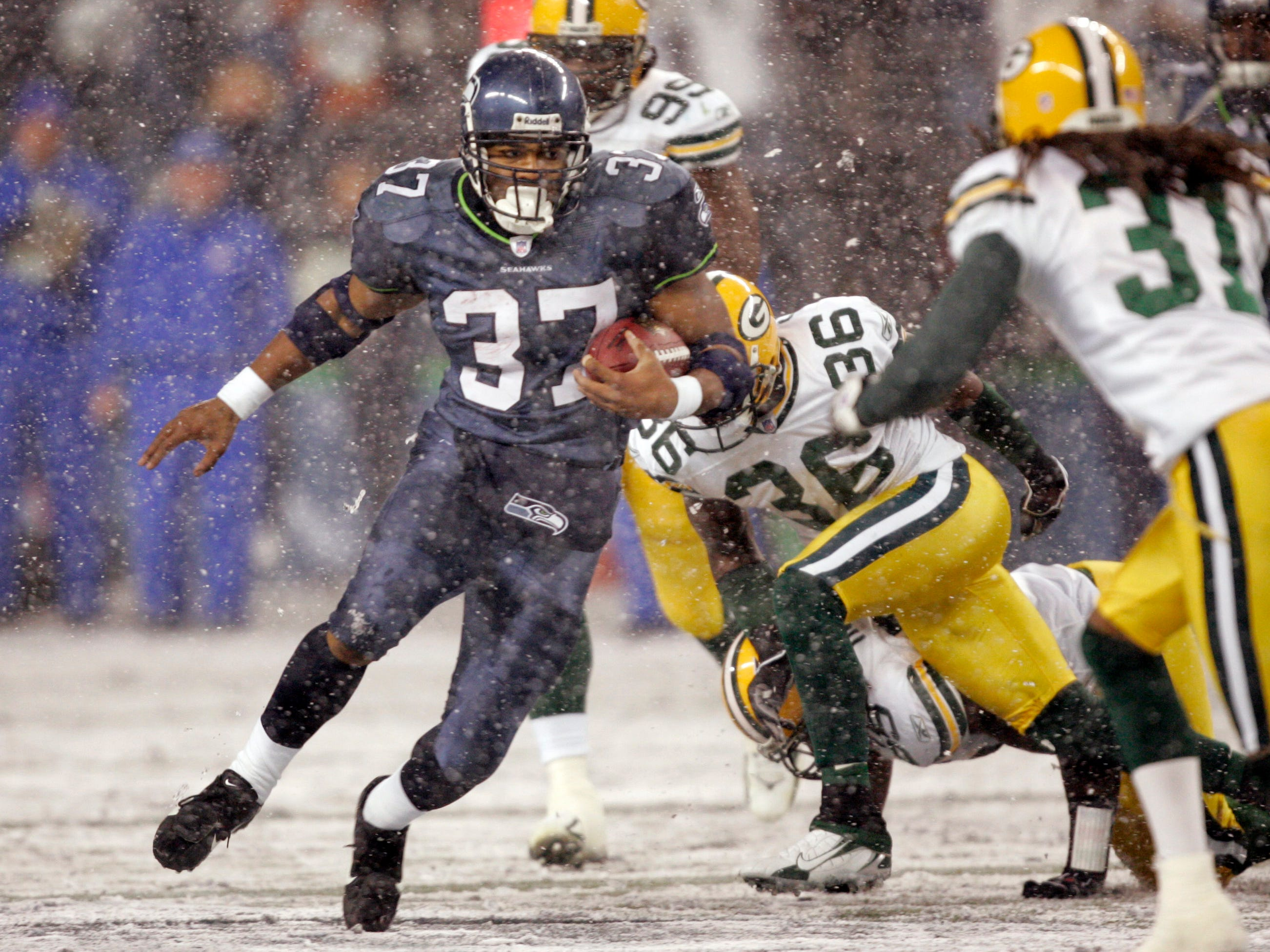 "Nov. 27, 2006: Seattle Seahawks running back Shaun Alexander rushes against the Green Bay Packers during a game in Seattle. Alexander ran for a season-high 201 yards to lead the Seahawks to a 34-24 win on ""Monday Night Football."""