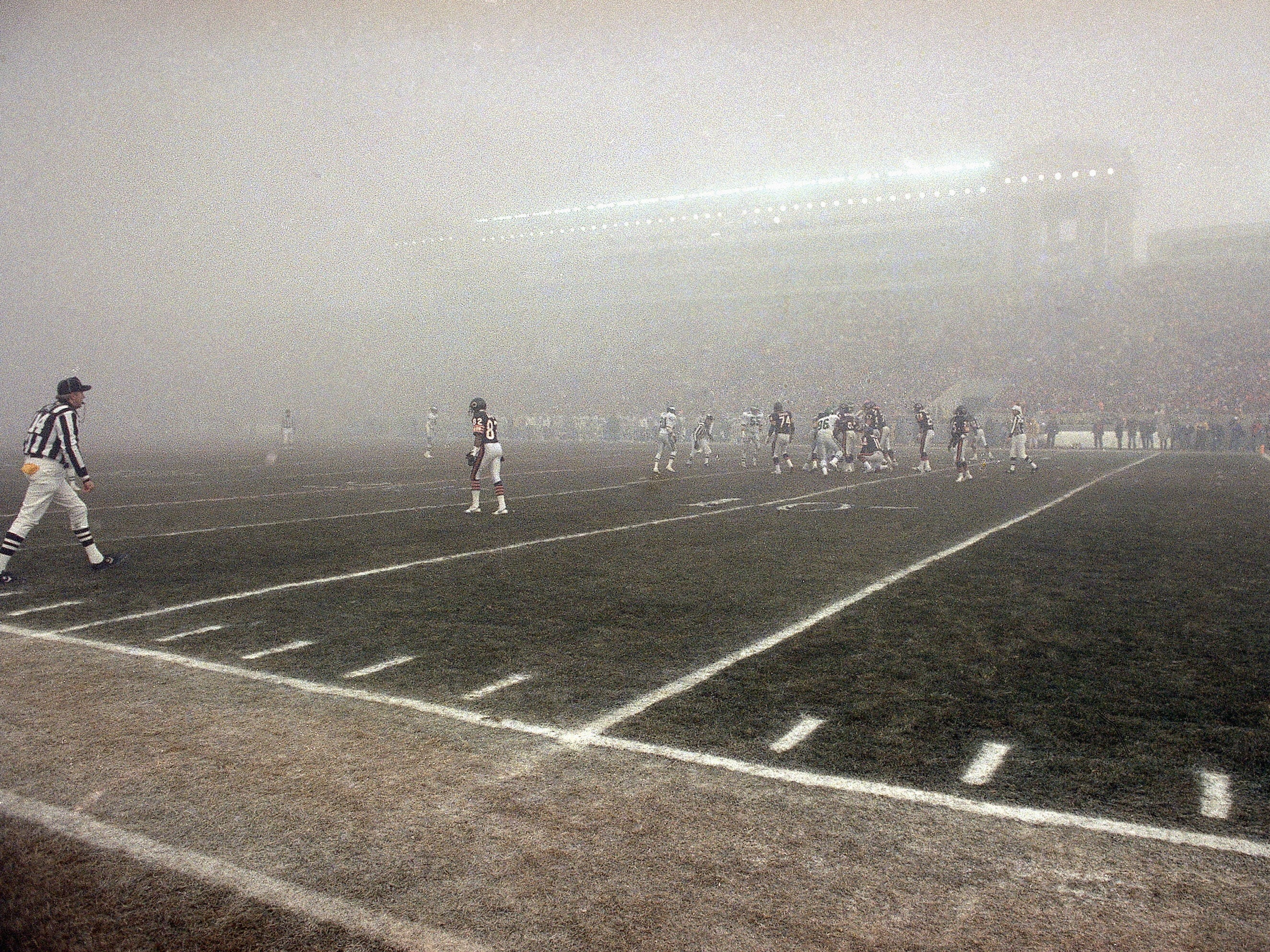 "Dec. 31, 1988: Tthe Chicago Bears and Philadelphia Eagles play in the famous ""Fog Bowl,"" a 1988 NFC divisional playoff game at Soldier Field. The Bears won the game, 20-12."