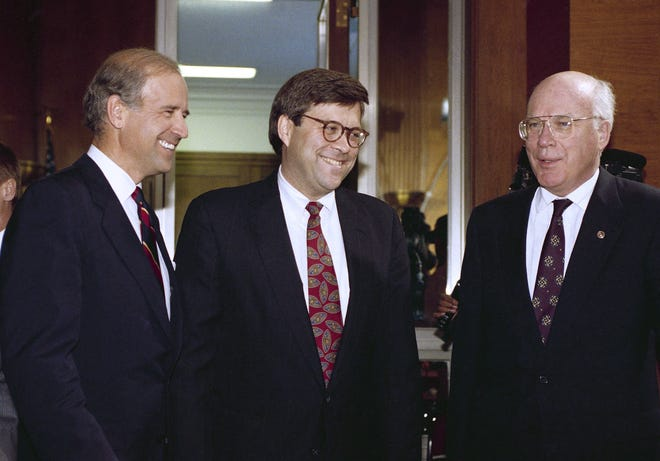 In a 1991 photo, attorney general nominee William Barr is flanked by Sen. Joseph Biden, D-Del., chairman of the Senate Judiciary Committee, left, and Sen. Patrick Leahy, D-Vt.