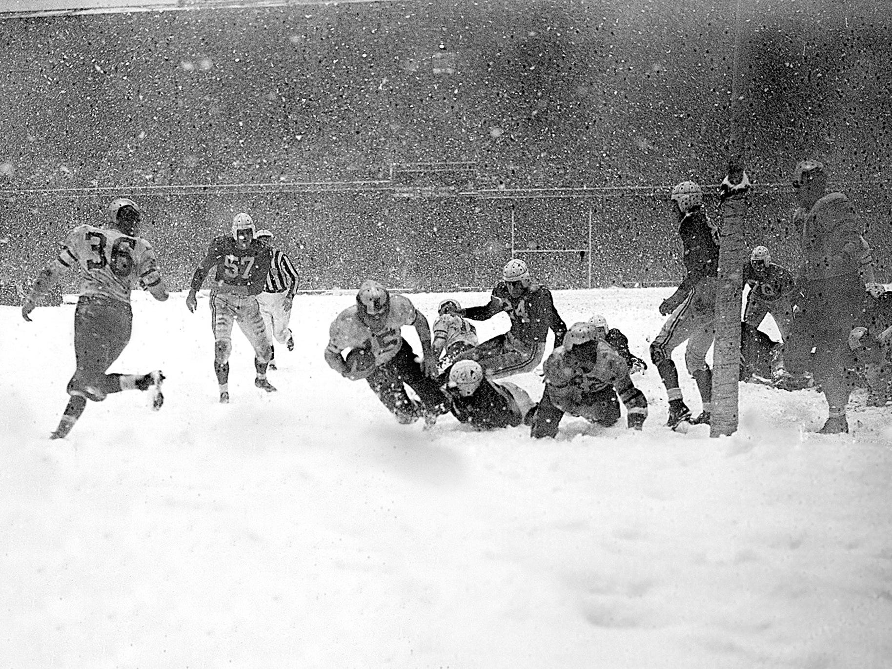 Dec. 19, 1948: Steve Van Buren (15) plunges over the goal line for the only touchdown in the Philadelphia Eagles' 7-0 win over the Chicago Cardinals in the 1948 NFL Championship Game at Shibe Park. The game was played during a significant snowfall.