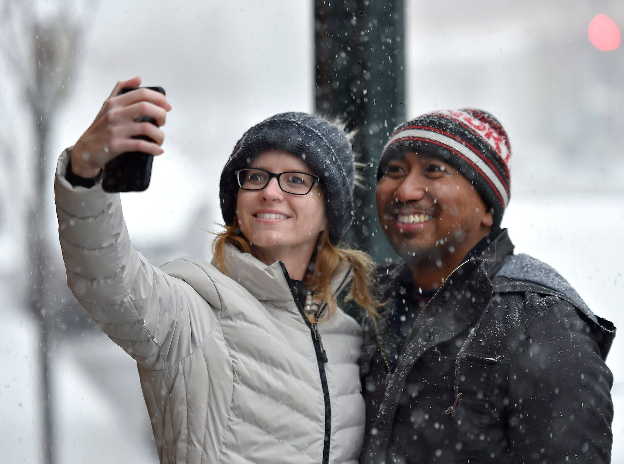 It was only the third time Kristin Brooker had seen snow, so a selfie was in order Sunday, Nov. 25,2018 with friend Dominic Francia, who grew up in Kansas City. The pair stopped on their walk around the Country Club Plaza just as the heavy snow began to fall. Both now live in Los Angeles.