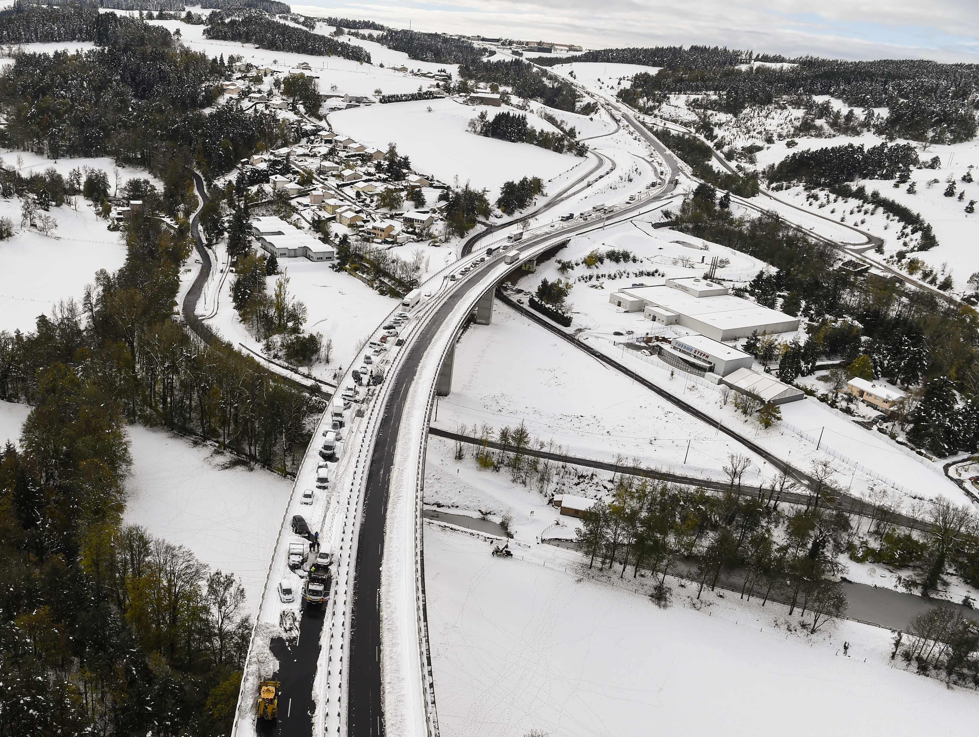 Aerial view shows trucks and cars blocked on the RN 88 on Oct. 30, 2018 near Firminy, in the Loire department, central eastern France.