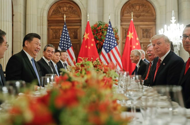 In this Dec. 1, 2018, photo, President Donald Trump, second from right, meets with China's President Xi Jinping, second from left, during their bilateral meeting at the G20 Summit, in Buenos Aires, Argentina.