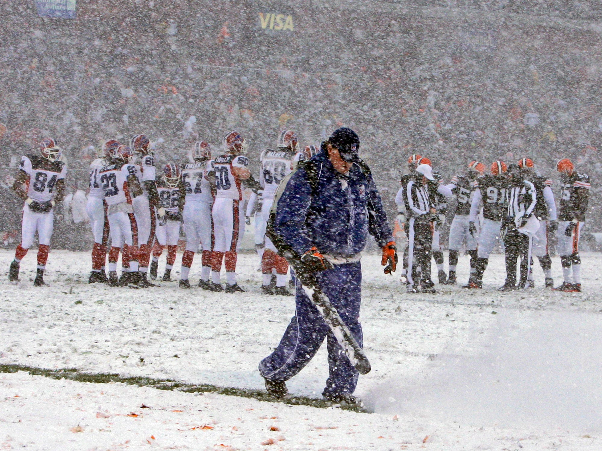 Dec. 16, 2007: A grounds crew worker blows snow off the field during a break in the action during the game between the Buffalo Bills and Cleveland Browns  in Cleveland. The Browns won the game, 8-0.