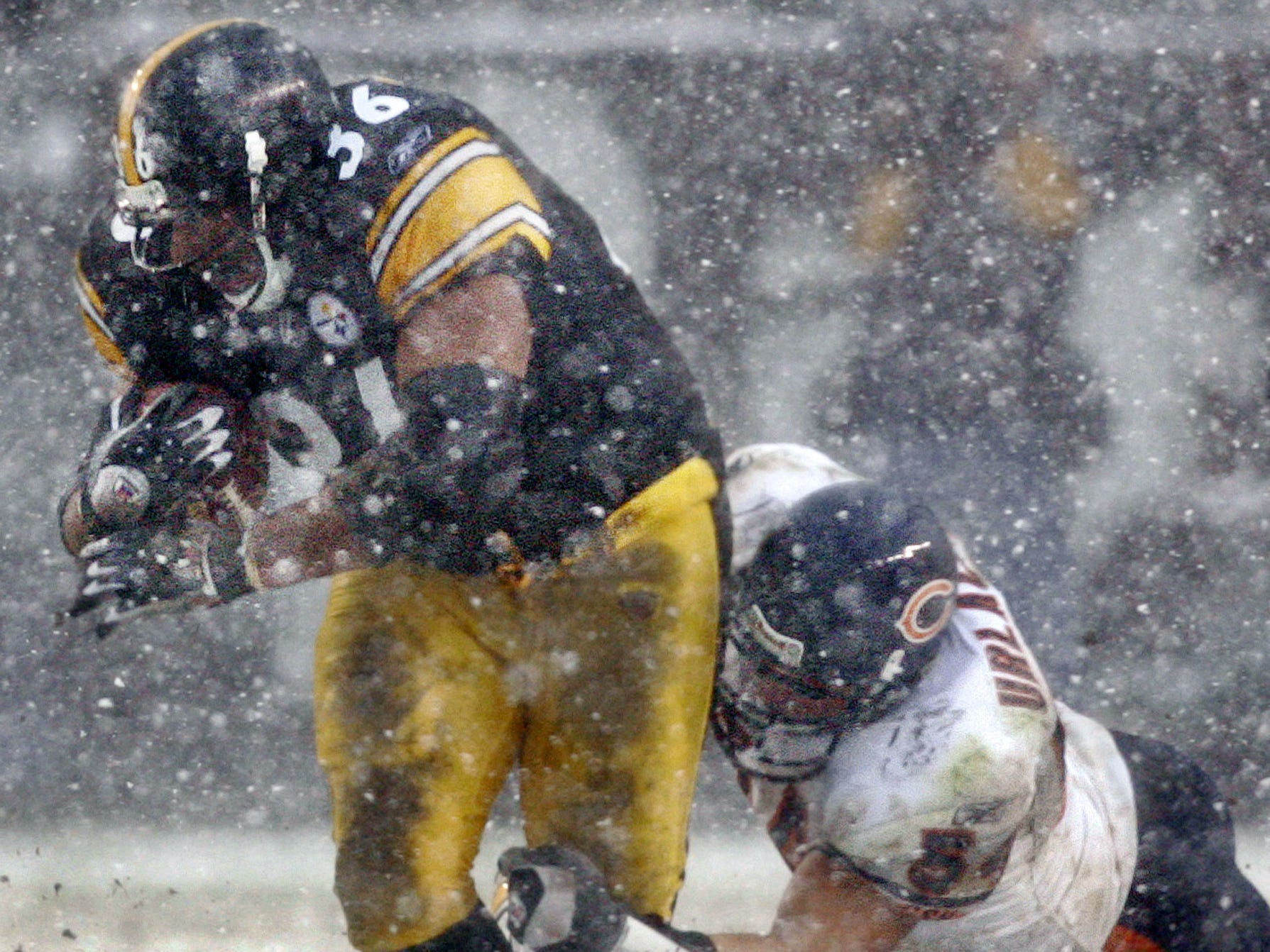 Dec. 11, 2005: Pittsburgh Steelers running back Jerome Bettis gets by Chicago Bears linebacker Brian Urlacher for a first down in the snow at Heinz Field. The Steelers won the game, 21-9.