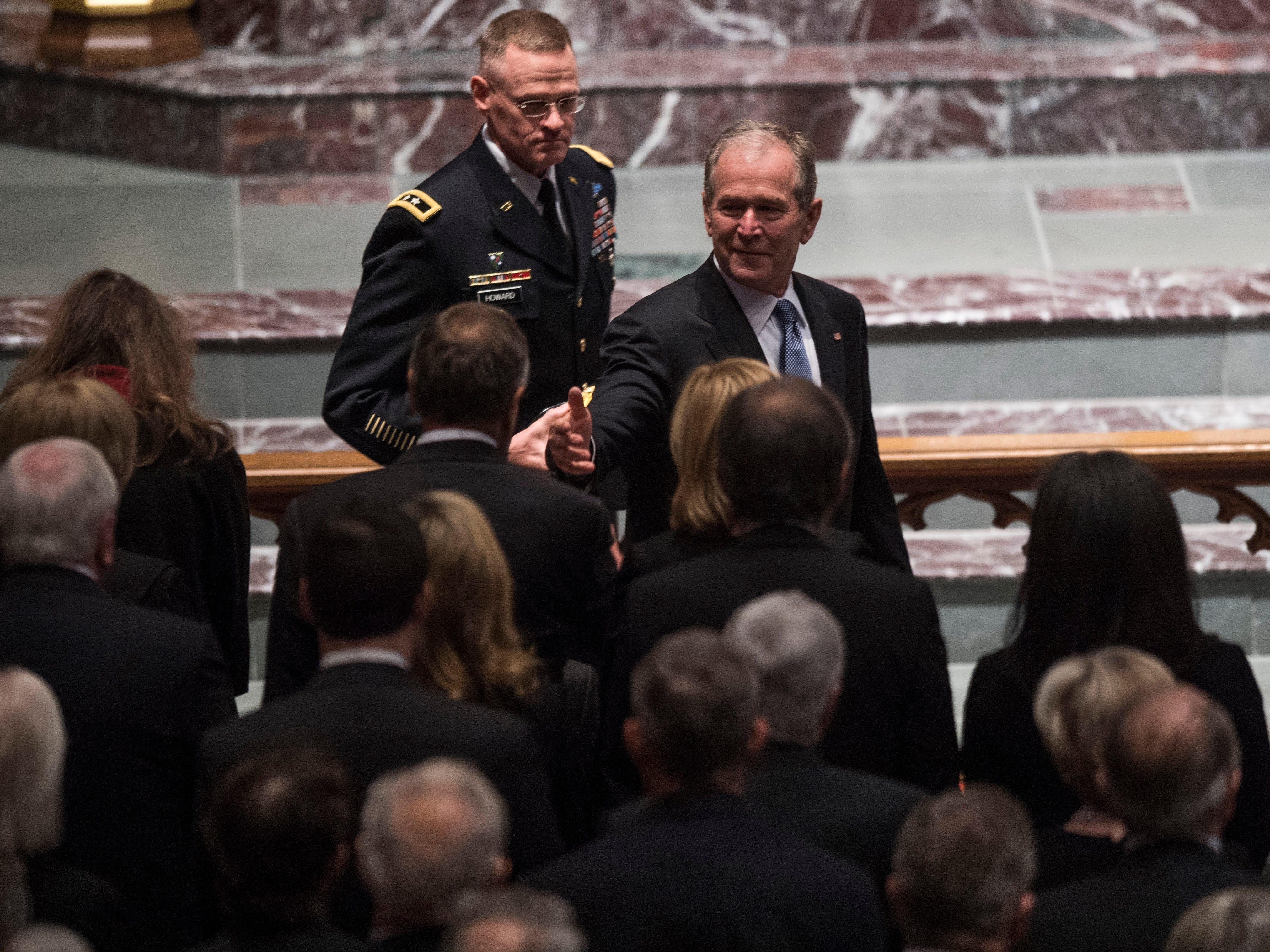 Former President George W. Bush arrives for the Funeral service for former President George H.W. Bush at St. Martin's Episcopal Church in Houston, Thursday, Dec. 6, 2018.