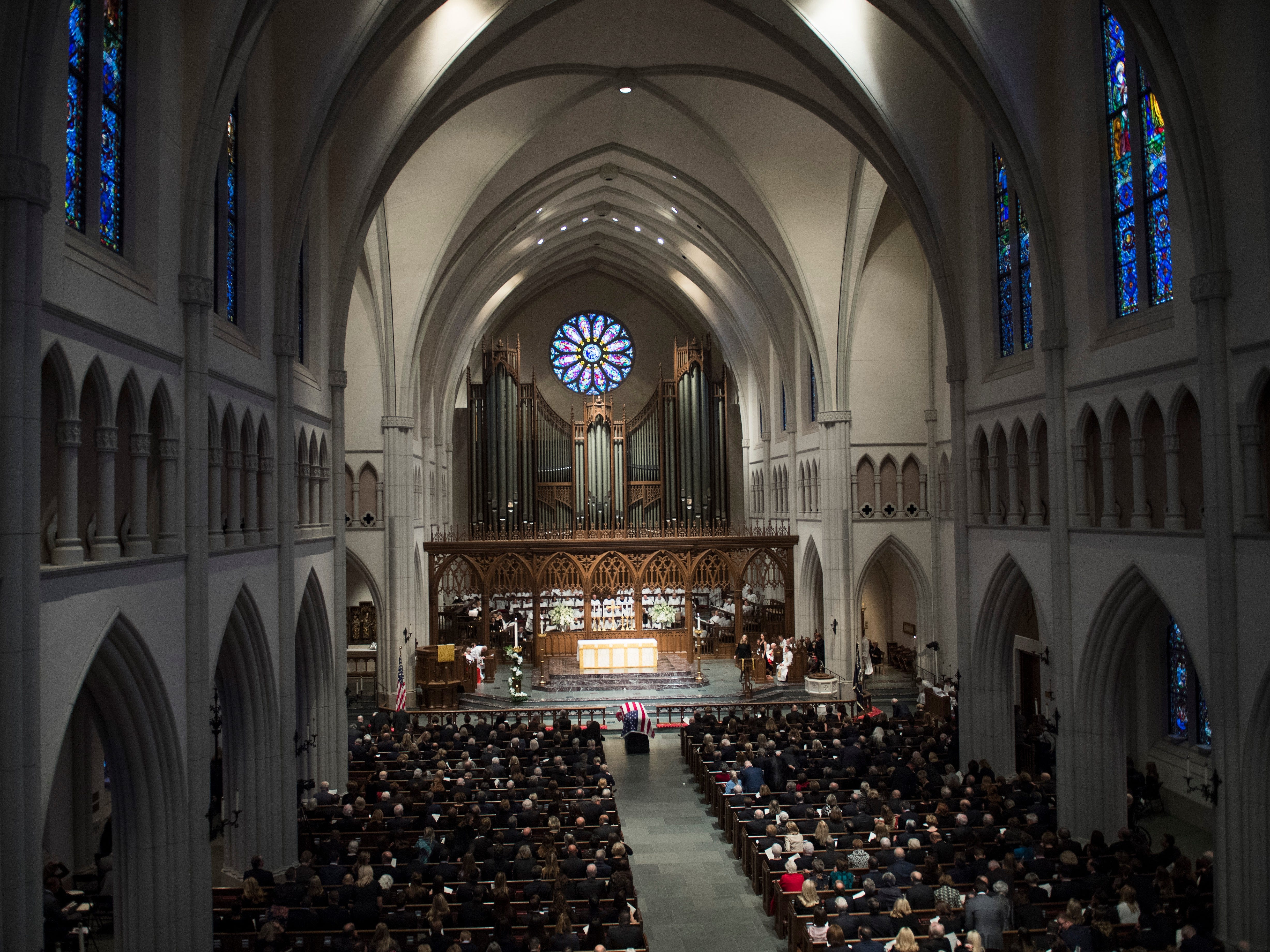People attend a funeral service for former President George H.W. Bush at St. Martin's Episcopal Church in Houston, Thursday, Dec. 6, 2018.