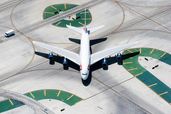 """A limited-edition print from photographer Laird Kay shows a """"head-on"""" shot of a British Airways A380. It's for sale as part of Kay's """"Runway Graphics"""" print collection."""