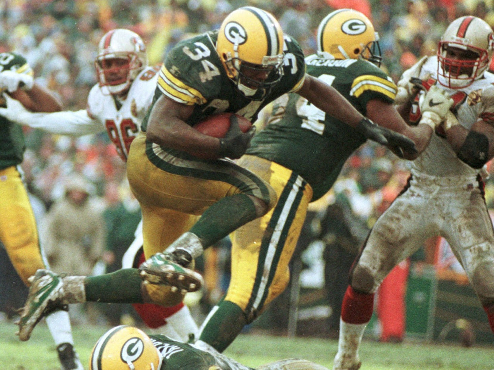 Jan. 4, 1997: Green Bay Packers running back Edgar Bennett hurdles teammate Aaron Taylor for a touchdown in Green Bay's 35-14 win in an NFC divisional playoff game against the San Francisco 49ers at Lambeau Field.