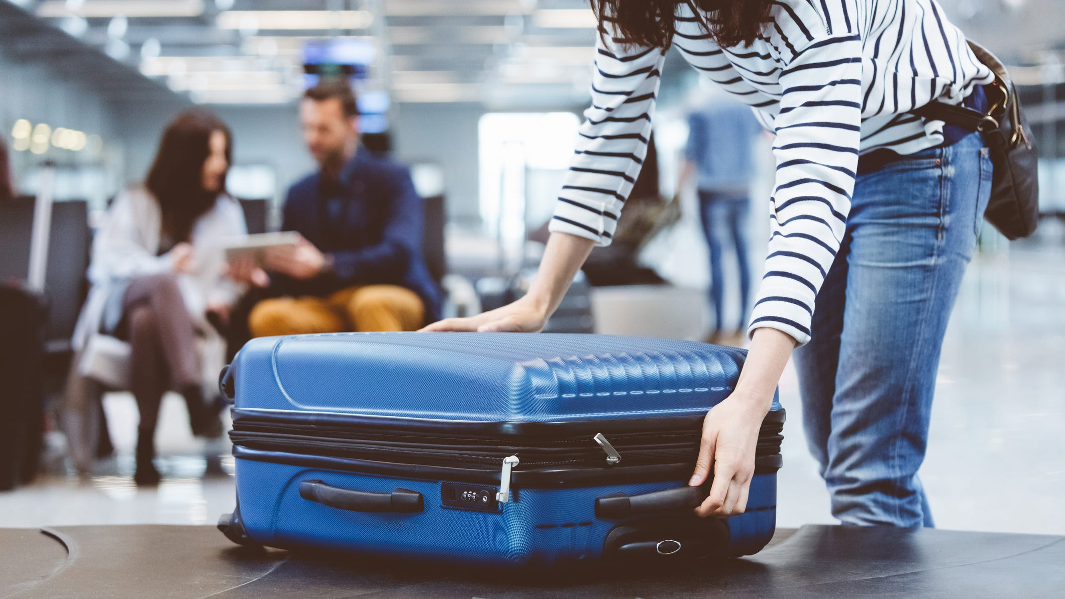 Free checked luggage is a common perk for many branded credit cards.