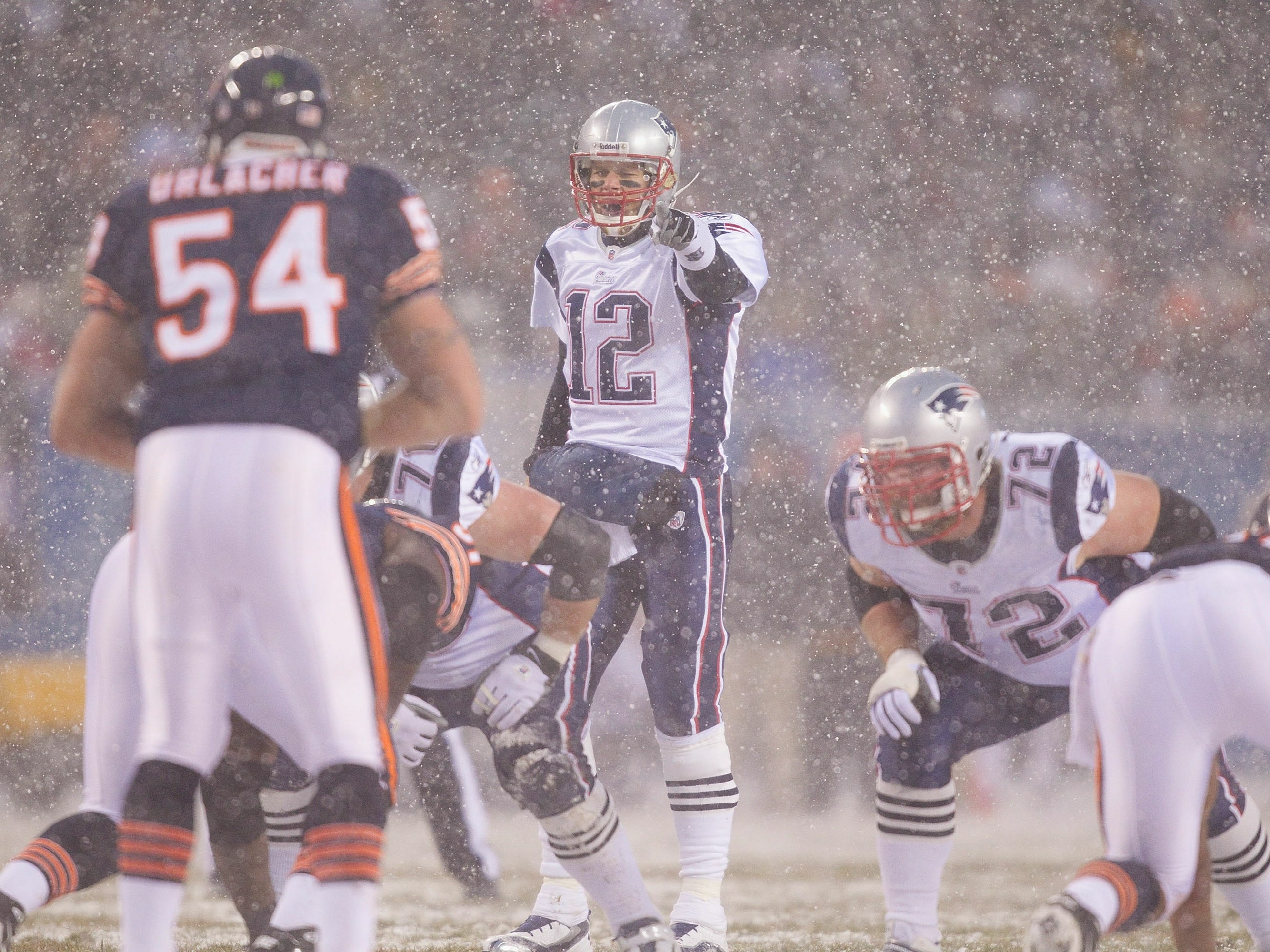 Dec. 12, 2010: New England Patriots quarterback Tom Brady directs the offense against the Chicago Bears at Soldier Field. The Patriots won the game, 36-7.