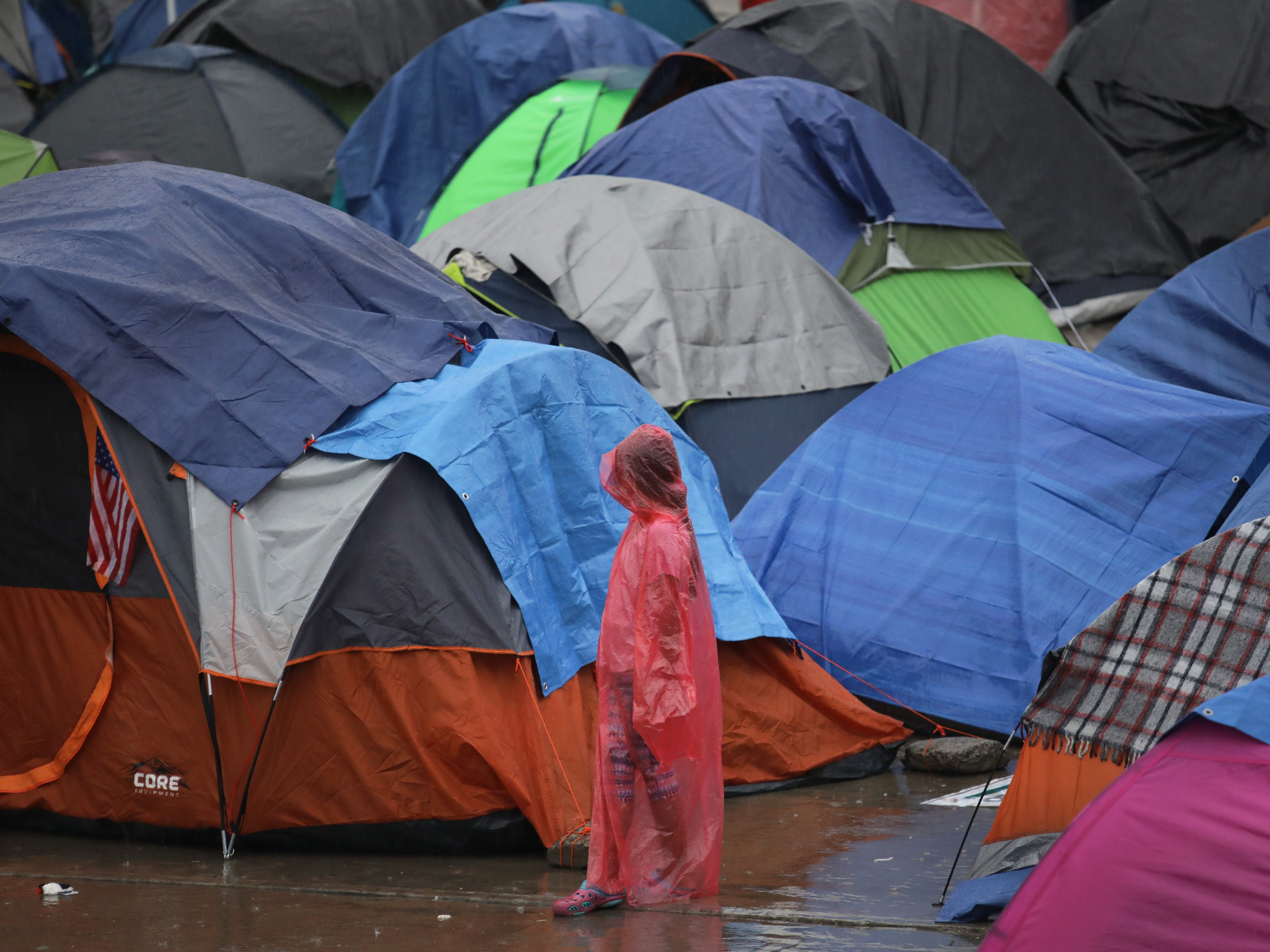 Rain falls on a migrant caravan camp on Dec. 5, 2018 in Tijuana, Mexico. Now near the U.S.-Mexico border after traveling more than six weeks from Central America, thousands of migrants are facing a challenging environment in their goal to enter the United States.