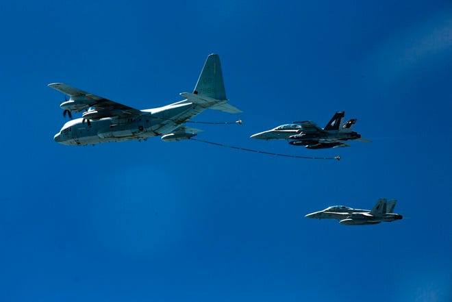 In this Oct. 13, 2016, photo provided by U.S. Marine Corps, two F/A-18D Hornets with Marine All-Weather Fighter Attack Squadron 533 approach a KC-130J with Marine Aerial Refueler Transport Squadron 352 during a Special Purpose Marine Air-Ground Task Force - Crisis Response - Central Command aerial refueling exercise in undisclosed location.
