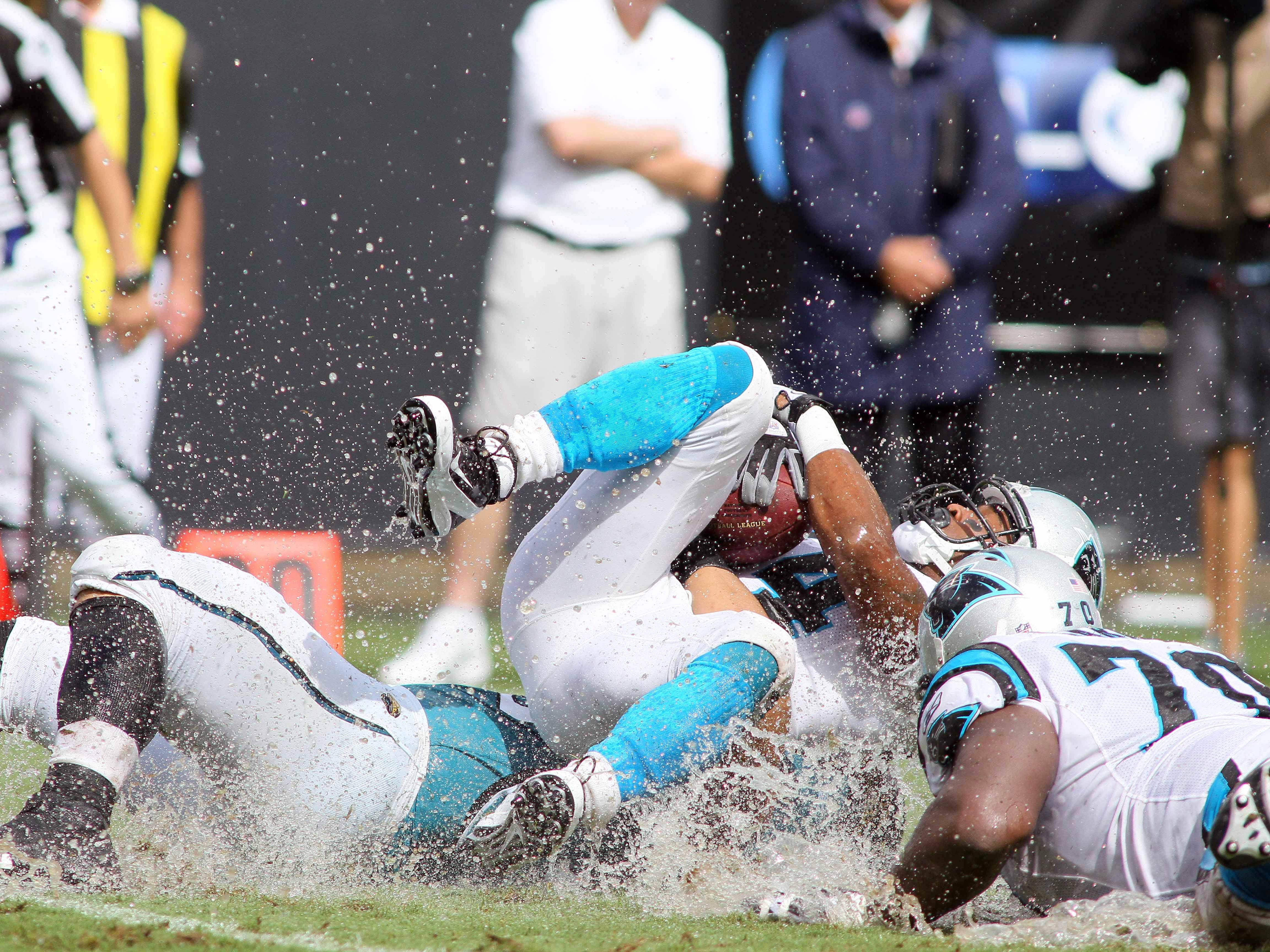 Sept. 25, 2011: Carolina Panthers running back DeAngelo Williams gets tackled by the Jacksonville Jaguars in the third quarter at Bank of America Stadium. The Panthers won the game, 16-10.
