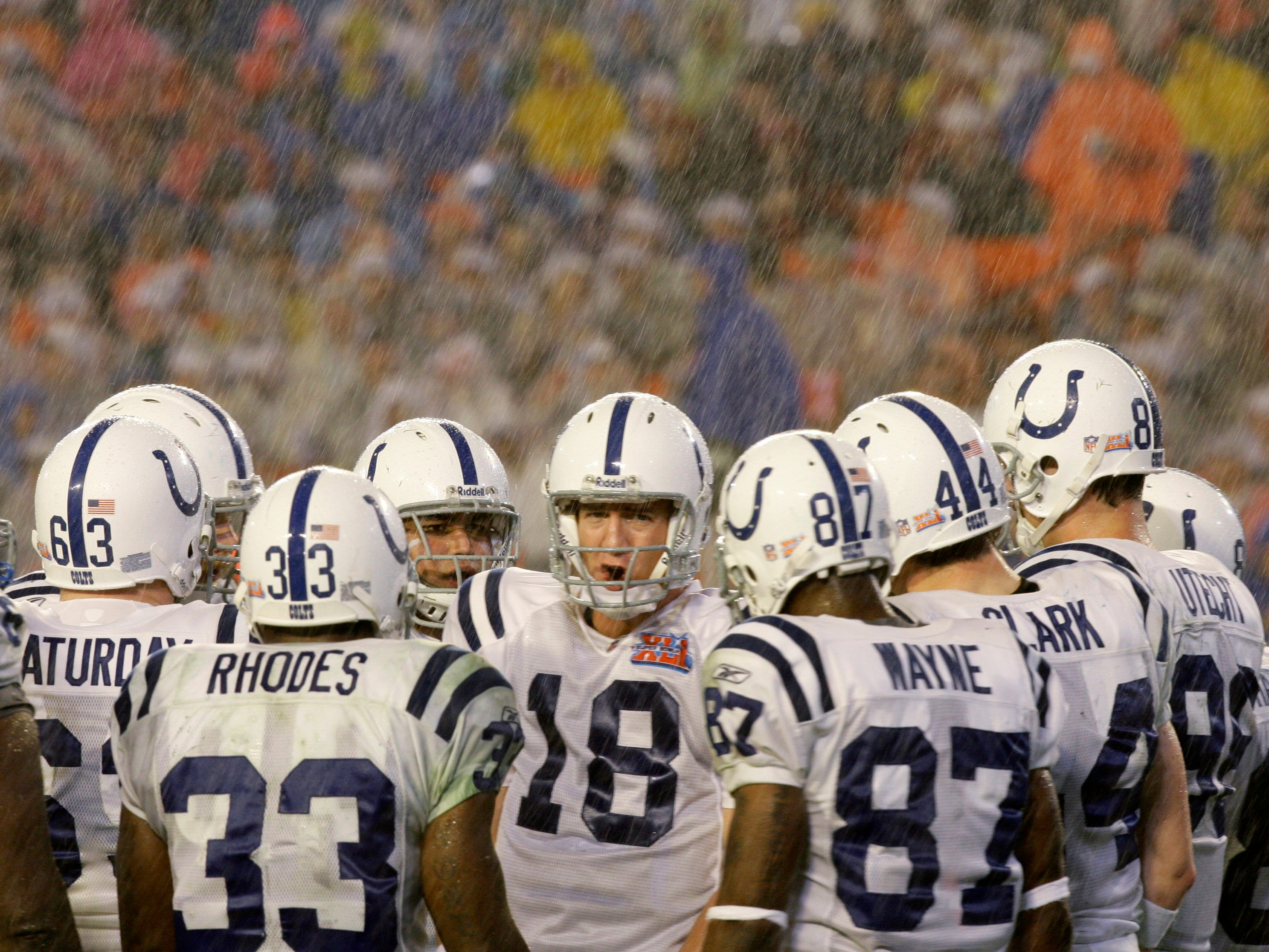 Feb. 4, 2007: Indianapolis Colts quarterback Peyton Manning directs his team in the huddle in the third quarter of the Super Bowl XLI against the Chicago Bears at Dolphin Stadium. The Colts won the game, 29-17, in the first Super Bowl played in the rain.