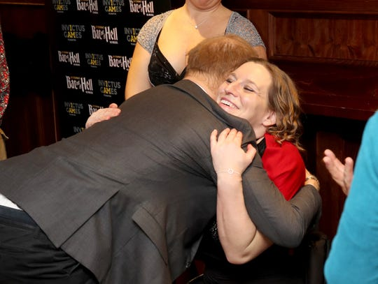 """Prince Harry hugs Nerys Pearce as he attends a gala performance of """"Bat Out Of Hell - The Musical"""" in support of the Invictus Games Foundation, Dec. 6, 2018 in London."""