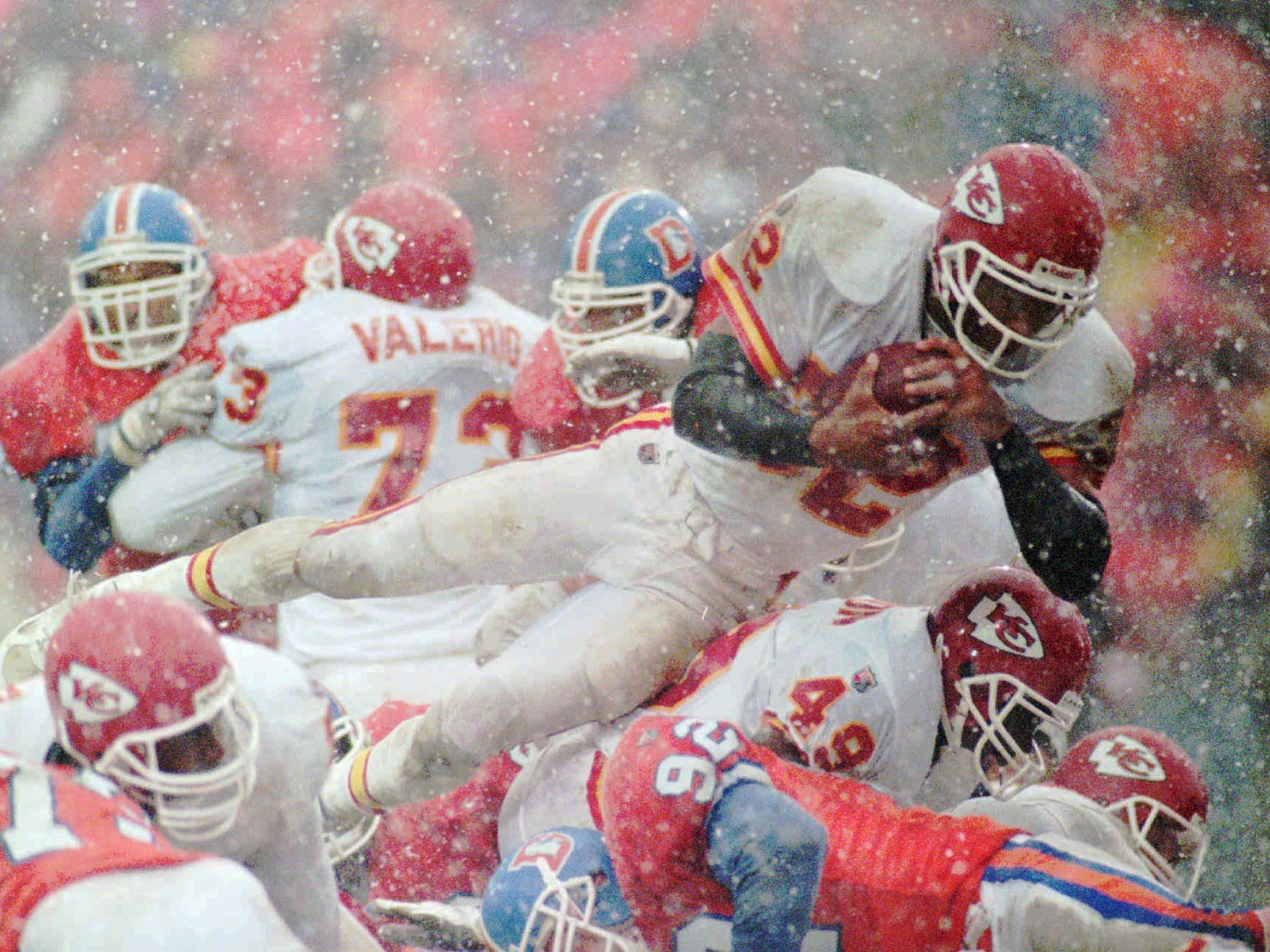 Oct. 22, 1995: Kansas City Chiefs running back Marcus Allen dives for a 1-yard touchdown against the Denver Broncos at Mile High Stadium. It was the 100th career NFL touchdown for Allen. The Chiefs won the game, 21-7 in a driving snow storm.