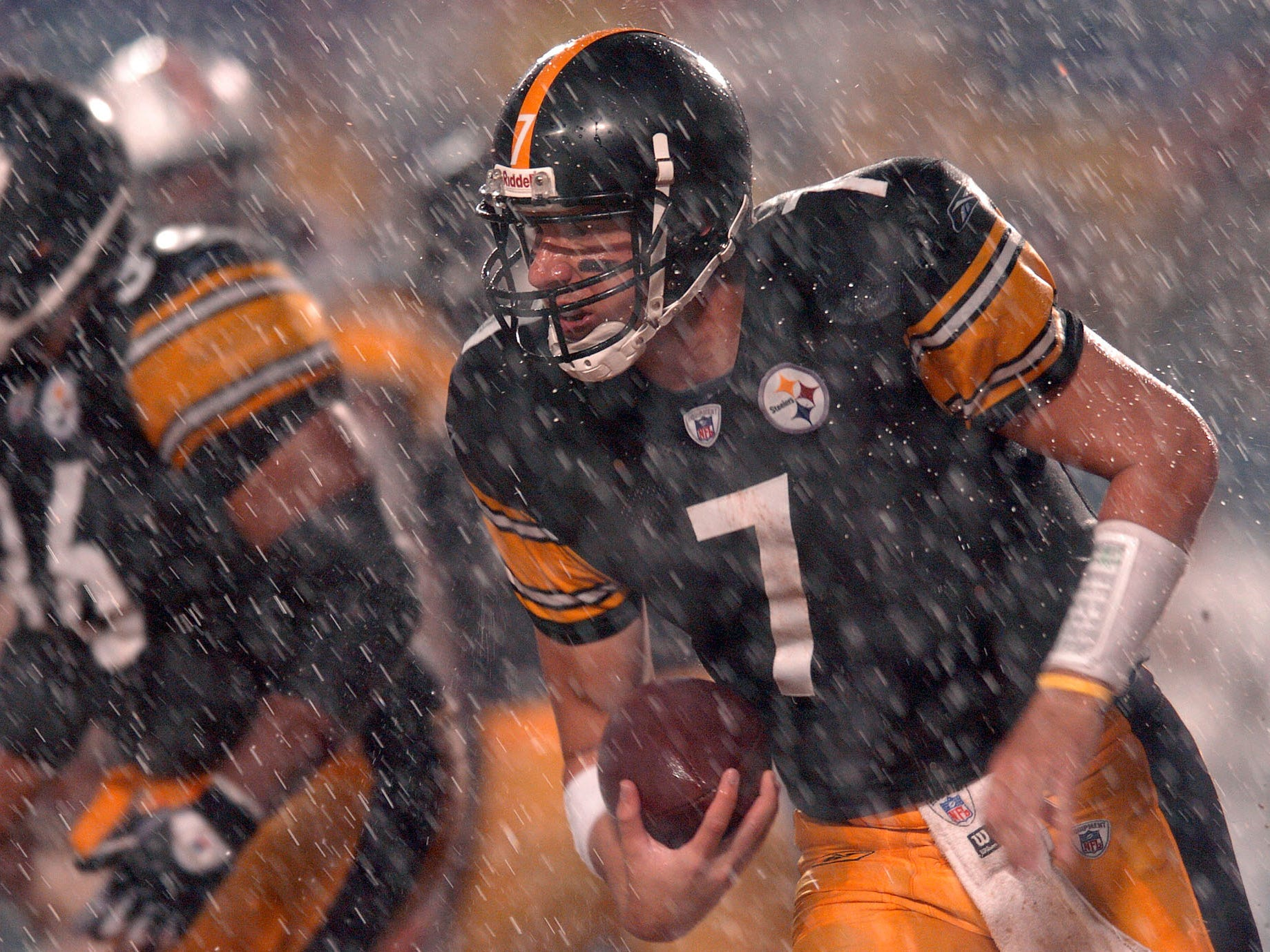 Sept. 26, 2004: Pittsburgh Steelers quarterback Ben Roethlisberger scrambles out of the pocket against the Miami Dolphins during a downpour in at Pro Player Stadium in Miami. The Steelers won the game, 13-3.