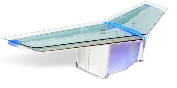 MotoArt.com's 'Delta Wingman' desk is made from the two rear stabilizers of a retired DC-9 jet.