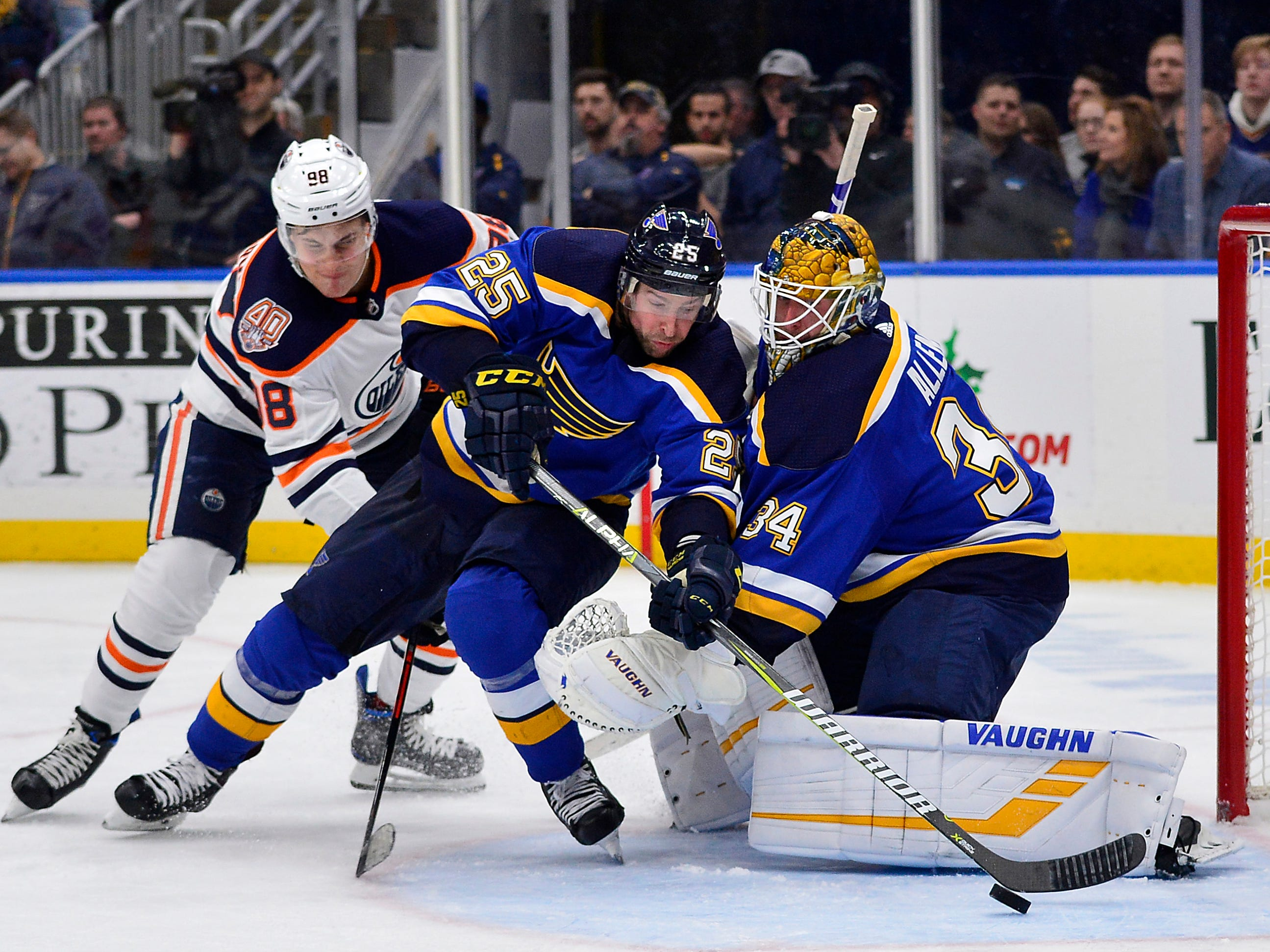 Dec. 5: St. Louis Blues defenseman Chris Butler (25) and goaltender Jake Allen (34) defend the net against Edmonton Oilers right wing Jesse Puljujarvi (98) during the third period at Enterprise Center. The Oilers won the game, 3-2.