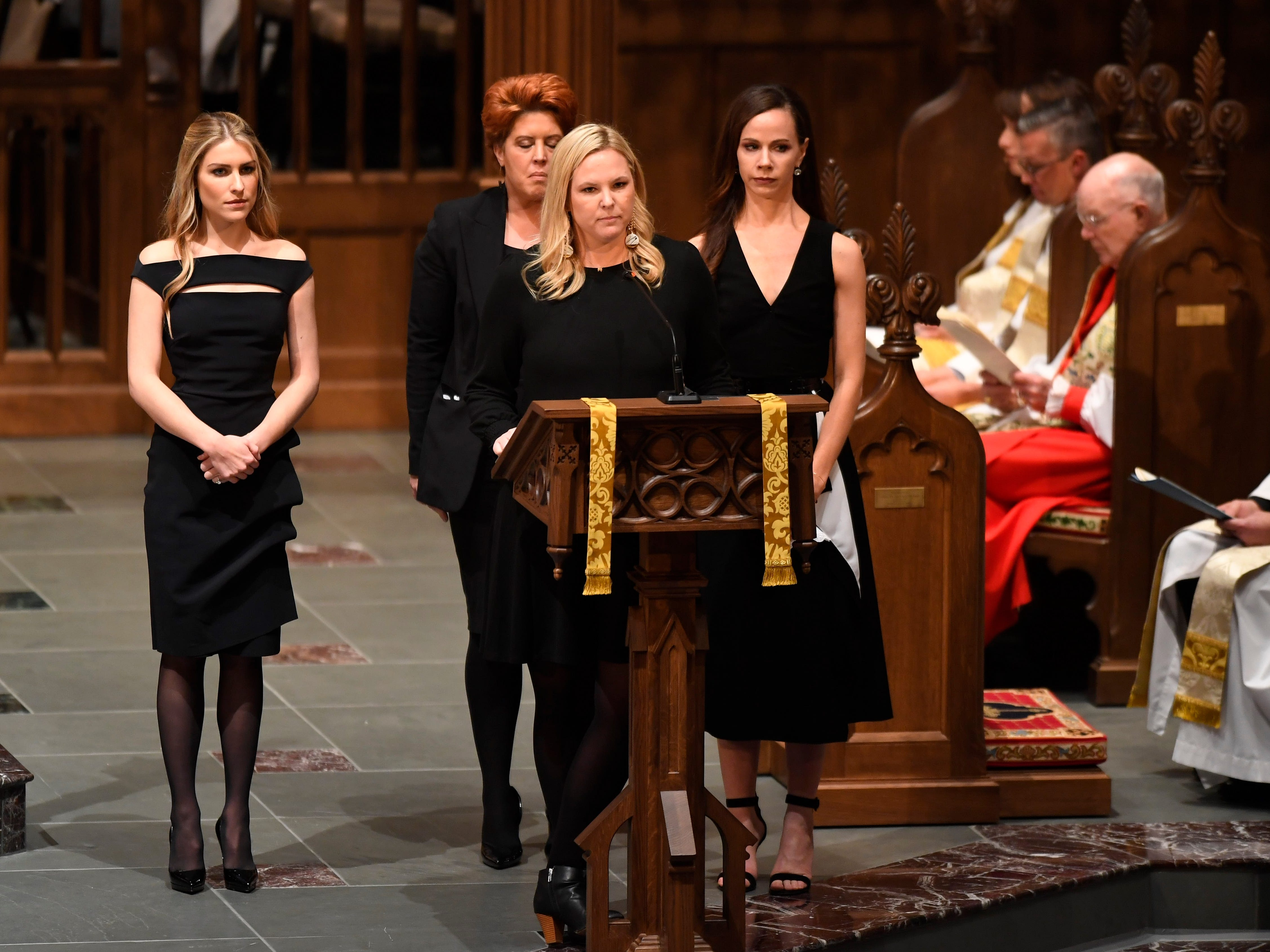 The granddaughters of former President George H.W. Bush speak during his funeral at St. Martin's Episcopal Church, Dec. 6, 2018, in Houston.